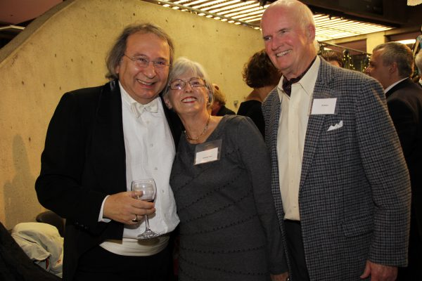 Symphony musician, Shimon Walt with his Musical Chair donors, Wendy and Eli Rees.'